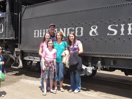 family in front of train