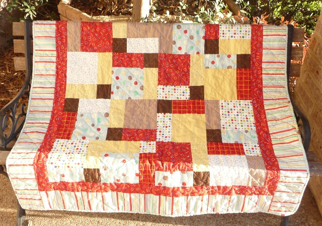 Finished lap quilt: diferent flavor of hidden/disappearing 9 patch.